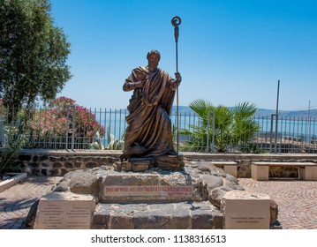 Capernaum, Galilee  May 18  2018:  Statue of St Peter in the village of Capernaum where he and Jesus lived with the Sea of Galilee in the background