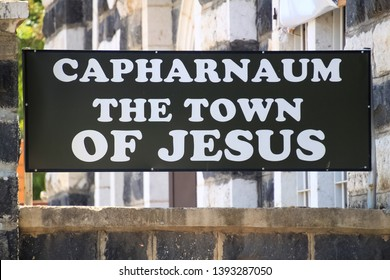 """Capernaum / Israel - 6/8/17: Sign at the entrance of Capernaum stating """"Capharnaum The Town of Jesus"""", home of Peter"""