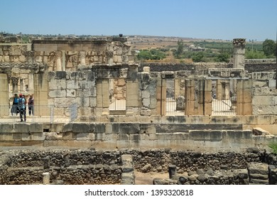 Capernaum / Israel - 6/8/17: Tourists explore the ancient ruins of a synagogue at Capernaum, Israel, home of St. Peter and Jesus
