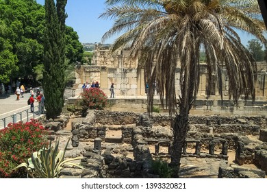 Capernaum / Israel - 6/8/17: Tourists explore the ancient city of Capernaum in Galilee region of Israel