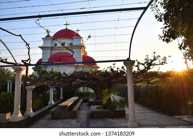 Capernaum, Israel - April 3, 2019: The Greek Orthodox Church of the Holy Apostles in Capernaum near the shore of the Sea of Galilee in Israel shown at sunset