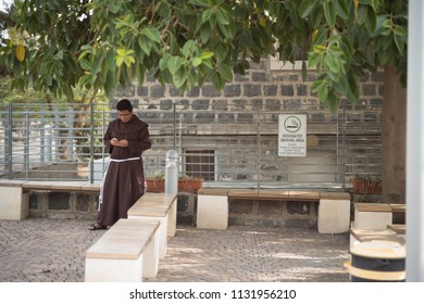 Capernaum, Israel - December 21 2017: A monk is meditating at the site of Capernaum Synagogues.
