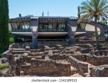 Capernaum, Israel   May 18  2018: Modern church over the  ruins of the dark basalt rock village of Capernaum, on the shore of the Sea of Galilee, where Jesus and St Peter lived and met other apostles