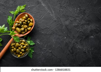 Capers Marinated capers in a bowl. Top view. free space for your text.