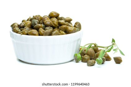 Capers in white bowl on white background