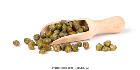 Capers in wooden spoon isolated on white background. Pickled capers. Canned capers.
