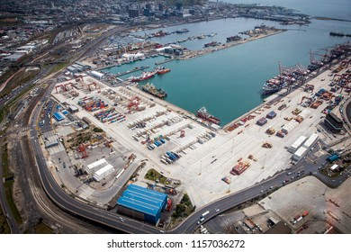 Capetown, South Africa - September, 2015: Helicopter view to Capetown port, docks, ships and cargo containers.