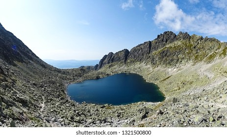 Capie pleso lake (Goat lake) in Mlynicka dolina (Mlynicka valley) in High Tatra mountains during sunny summer day, Tatras National Park, close to Strbske Pleso town or Poprad, Slovakia, Eastern Europe