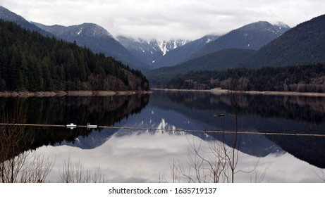 Capilano River Regional Park, North Vancouver, BC, Canada. View on Capilano Lake. Cloudy day