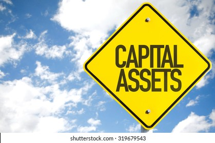 Capital Assets sign with sky background