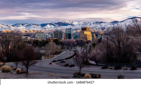 Capital boulevard and morning skyline of Boise with snow in the foothills