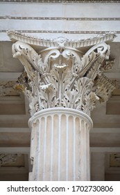 Capital of a Corinthian Column with acanthus decoration in the pronaos of an Ancient Roman Temple in Nimes, France
