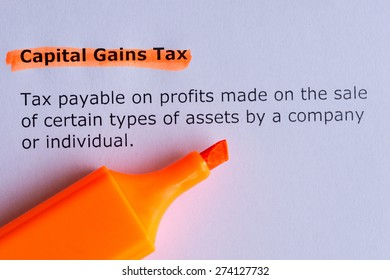 capital gains tax word highlighted on the white pa