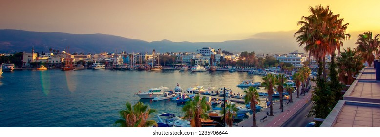 The capital of the island of Kos, Greece, view of the city and marina at sunset, a popular destination  in Europe, banner panoramic view