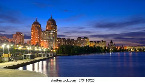 Capital of Ukraine, Kiev. Obolon embankment of the Dnieper River in Kyiv in the evening