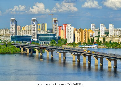 Capital of Ukraine, Kiev. Paton bridge and new residential district on the left coast of Dnieper in Kyiv.
