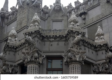 "Capital and the upper part of the facade with sculptures of animals on the historic Art Nouveau building, called ""House with Chimeras"" (built in 1902), Kiev, Ukraine"