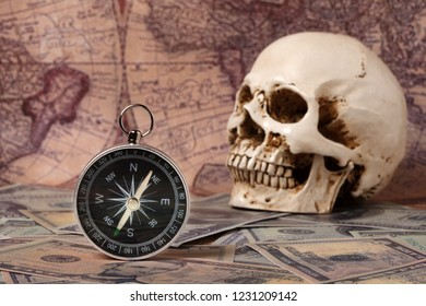 Capitalism Concept : Skull and Compass on Banknote with Vintage Map Background