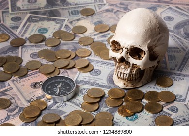 Capitalism concept : Skull on banknote, coin ,compass  and vintage map background.