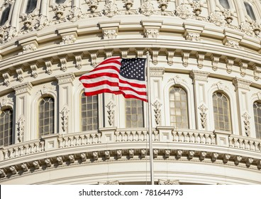 Capitol Building dome detail with waving American flag - close up view, Washington DC, United States of America