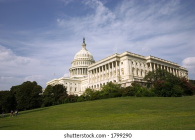 capitol building with green grass and cloudy sky as copy space