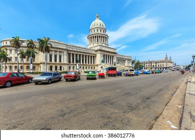 The Capitol building and heavy traffic of city center,  Havana, Cuba