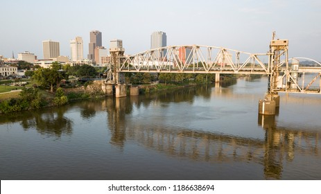 The capitol city of Arkansas in Little Rock is behind the transformed railroad bridge