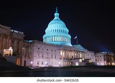 Capitol hill building at night illuminated with light, Washington DC.