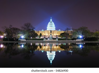 Capitol hill building at night illuminated with light with lake reflection, Washington DC.