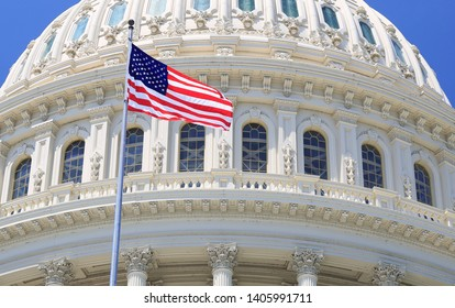 Capitol roof detail with American flag waving, Washington DC, USA