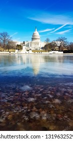Capitol in Washington DC. Photo January 23, 2019.  Capitol and reflection in frozen pond