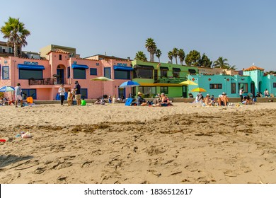 Capitola, CA, USA - September 20, 2020: People relaxing on the beach after quarantine. Life after the coronavirus pandemic.