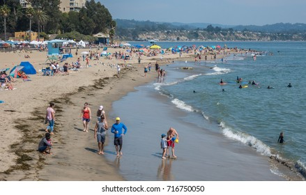 Capitola, California - September 10, 2017: People, including families and friends, enjoy a sunny summer day along the Pacific Coast at the beach in Capitola, in Santa Cruz County