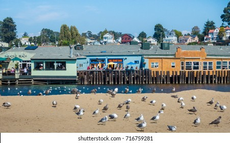 Capitola, California - September 10, 2017: People enjoy beach side dining on a sunny summer day along the Pacific Coast in Capitola, in Santa Cruz County.
