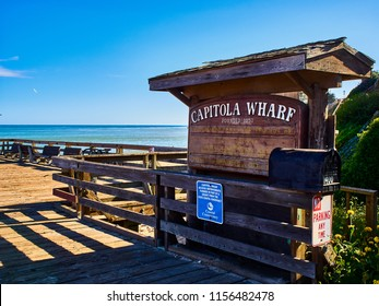 Capitola, California / US - April 2018. Entrance sign on the Capitola Wharf looking to the ocean, found 1857, Capitola, California