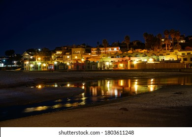 Capitola, California, USA. February 25, 2018. A reflection in a tide pool of vacation beach rentals in the west coast city of Capitola By the Sea.
