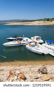 CAPITOLIO, MINAS GERAIS / BRAZIL - NOVEMBER 14, 2017: Motorboats used for rides on the Furnas lake anchored at the meeting point at KM 306 of MG-050 highway, near Rio Turvo bridge.