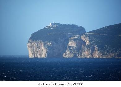 Capo Caccia Light House, on the cliffs of Alghero.  Bay of Alghero, Sardinia,  Italy.