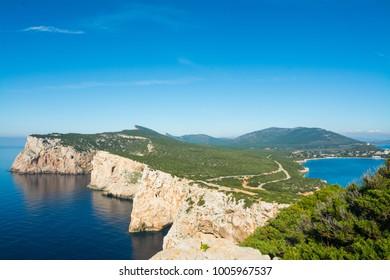 Capo Caccia under a blue sky. Sardinia, Italy
