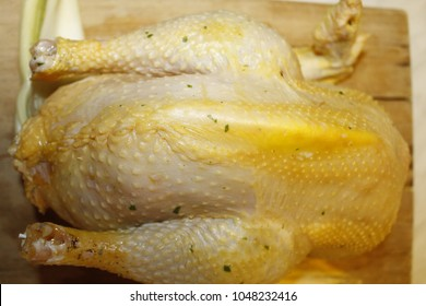 capon on wooden cutting board