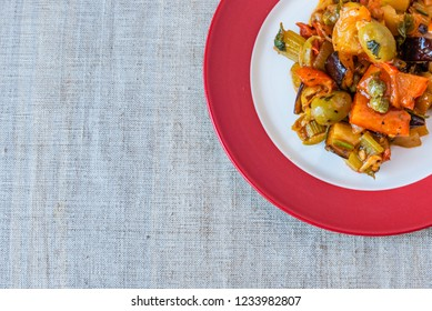 Caponata siciliana on a beautiful plate close-up, top view, copy space for recipe