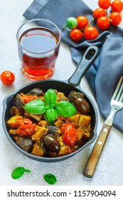 Caponata is a traditional Sicilian dish. Stew of vegetables-eggplant, tomatoes, onions, Basil and olives with seasonings and spices. Selective focus