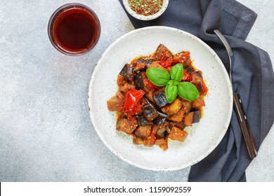 Caponata is a traditional Sicilian dish. Stew of vegetables-eggplant, tomatoes, onions, Basil and olives with seasonings and spices. Selective focus, copy space