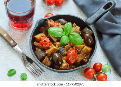Caponata is a traditional Sicilian dish. Stew of vegetables-eggplant, tomatoes, onions, Basil and olives Kalamata  with seasonings and spices. Selective focus