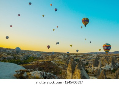 Cappadocia, Goreme, Anatolia, Turkey: Colorful hot air balloons flying over rock landscape, Cappadocia is known around the world with hot air balloons and is a beautiful place