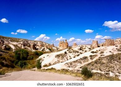 "Cappadocia, Kapadokya Otelleri, semi-arid region in central Turkey, is known for its distinctive ""fairy chimneys,"" tall, cone-shaped rock formations clustered in Monks Valley, Göreme, Turkey"