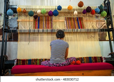CAPPADOCIA - MAY 17 : Woman working at the manufacture of carpets, on May 17, 2013, in Cappadocia, Turkey. Turkish rugs are one of the main economic sectors of the country.