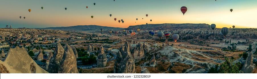 Cappadocia Panoramic - Hot air balloon flying over rock landscape at Cappadocia Turkey