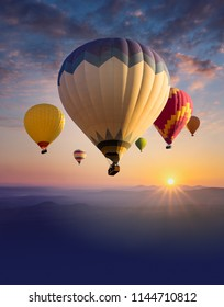 Cappadocia at sunrise - landscape with hot air balloons flying over mountain valley in sunlight and mist. Vertical billboard with place for text bottom for ballooning festival or travel background.
