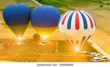 Cappadocia Tour Hot Air Balloons, Group hot-air balloons ready to fly over Cappadocia Goreme National Park. Turkey.